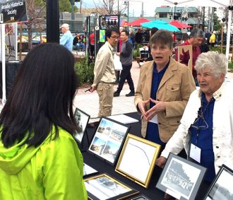 Karen Hou, center, and Carol Libby sharing historical images of the city of Arcadia.