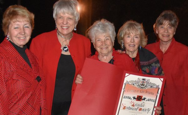 Arcadia Historical Society members with the Los Angeles County commemorative scroll. From left, Sandy Snider, Gail Marshall, Carol Libby, Beth Costanza and Karen Hou.